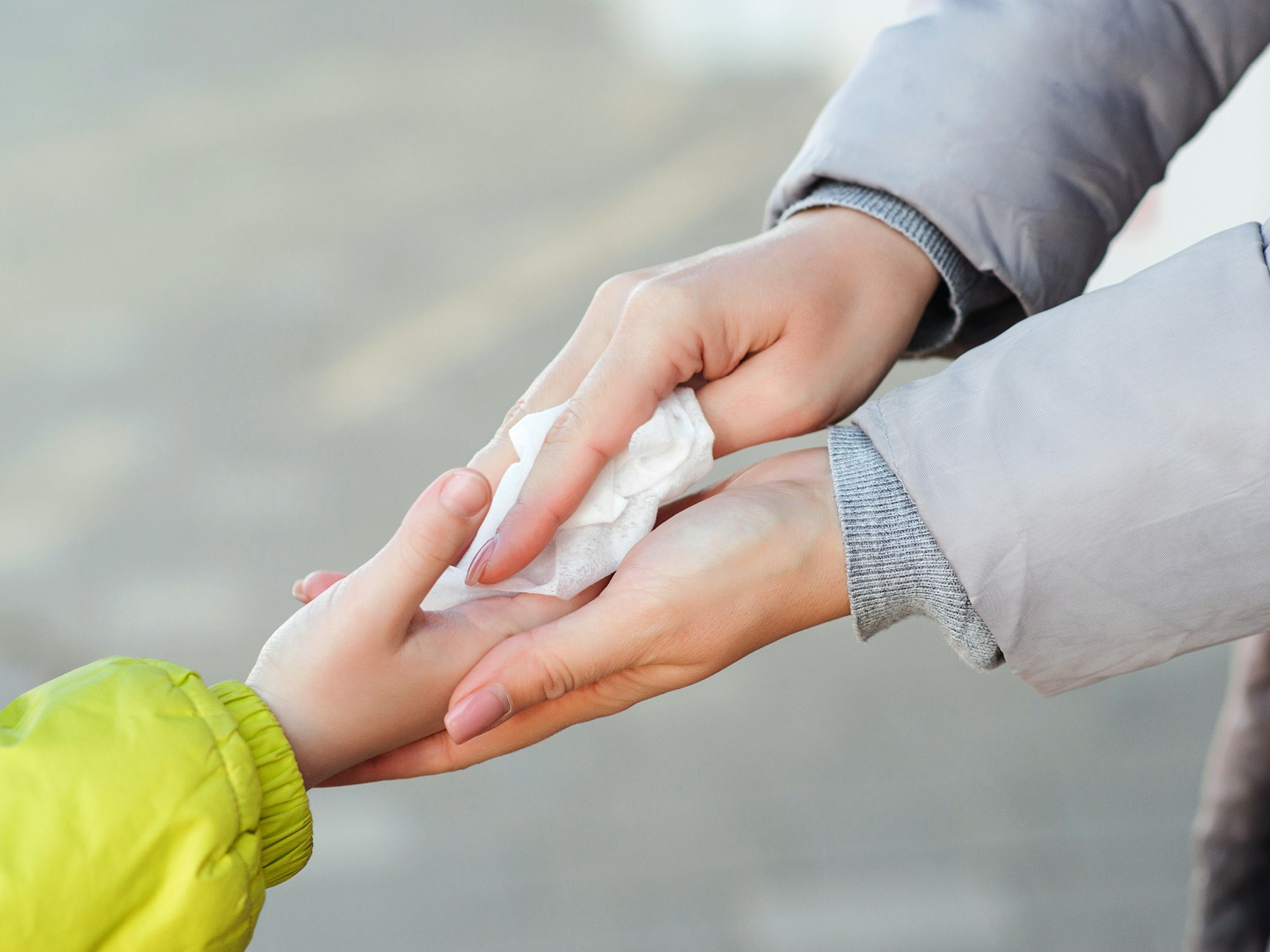 An image of a child using antibacterial wipes to represent their importance in the upcoming return to schools.