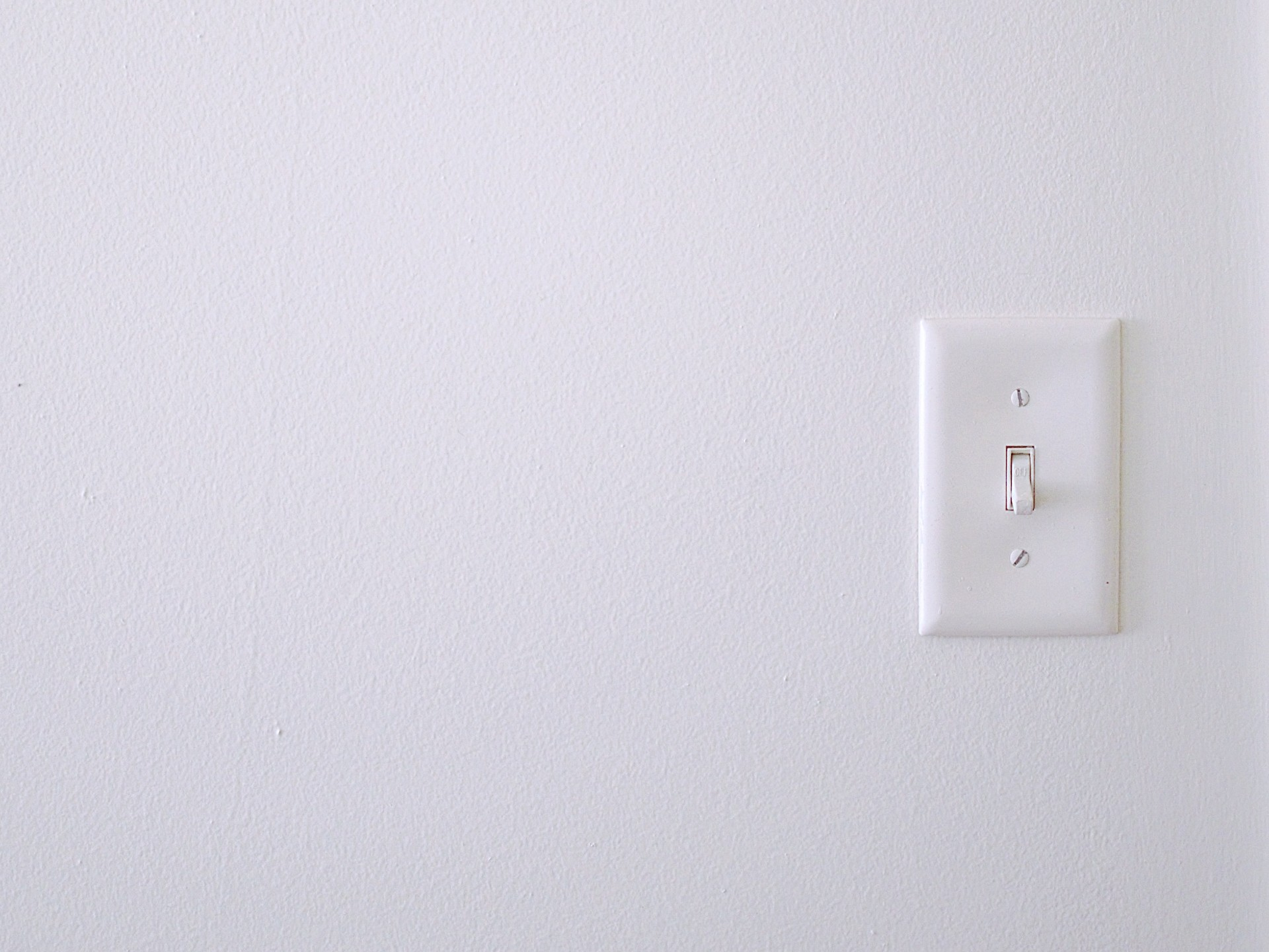 A light switch to represent surfaces often forgotten about in terms of wiping with antibacterial wipes.