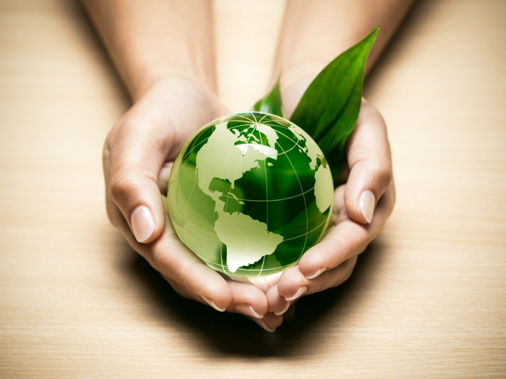 A green planet to represent how using biodegradable wipes can combat climate change.