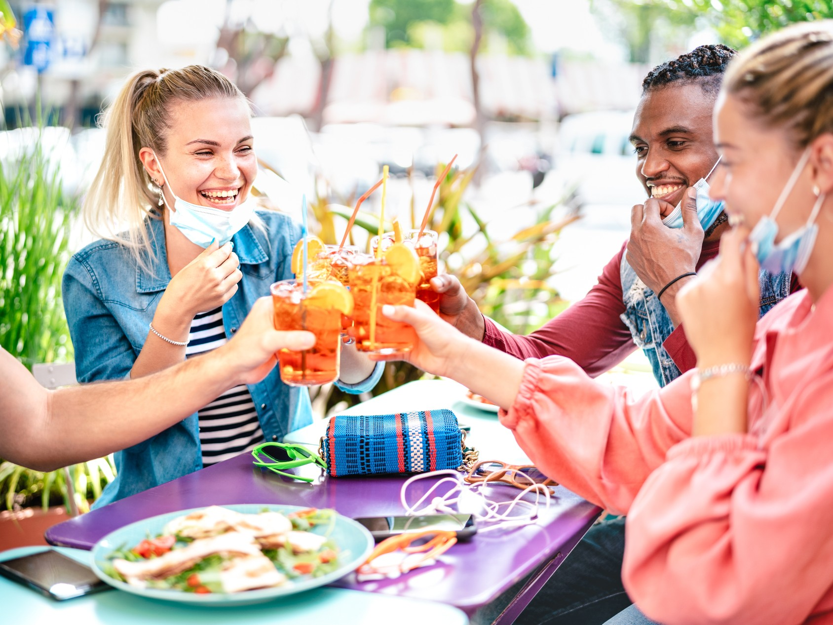 An image of diners during the pandemic eating outdoors to represent the importance of hand wipes for restaurants when they reopen, soon.