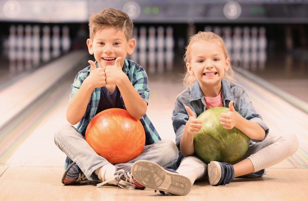 Children at bowling alley reflecting how our role as private label wet wipe manufacturers can help reassert confidence into the leisure industry.