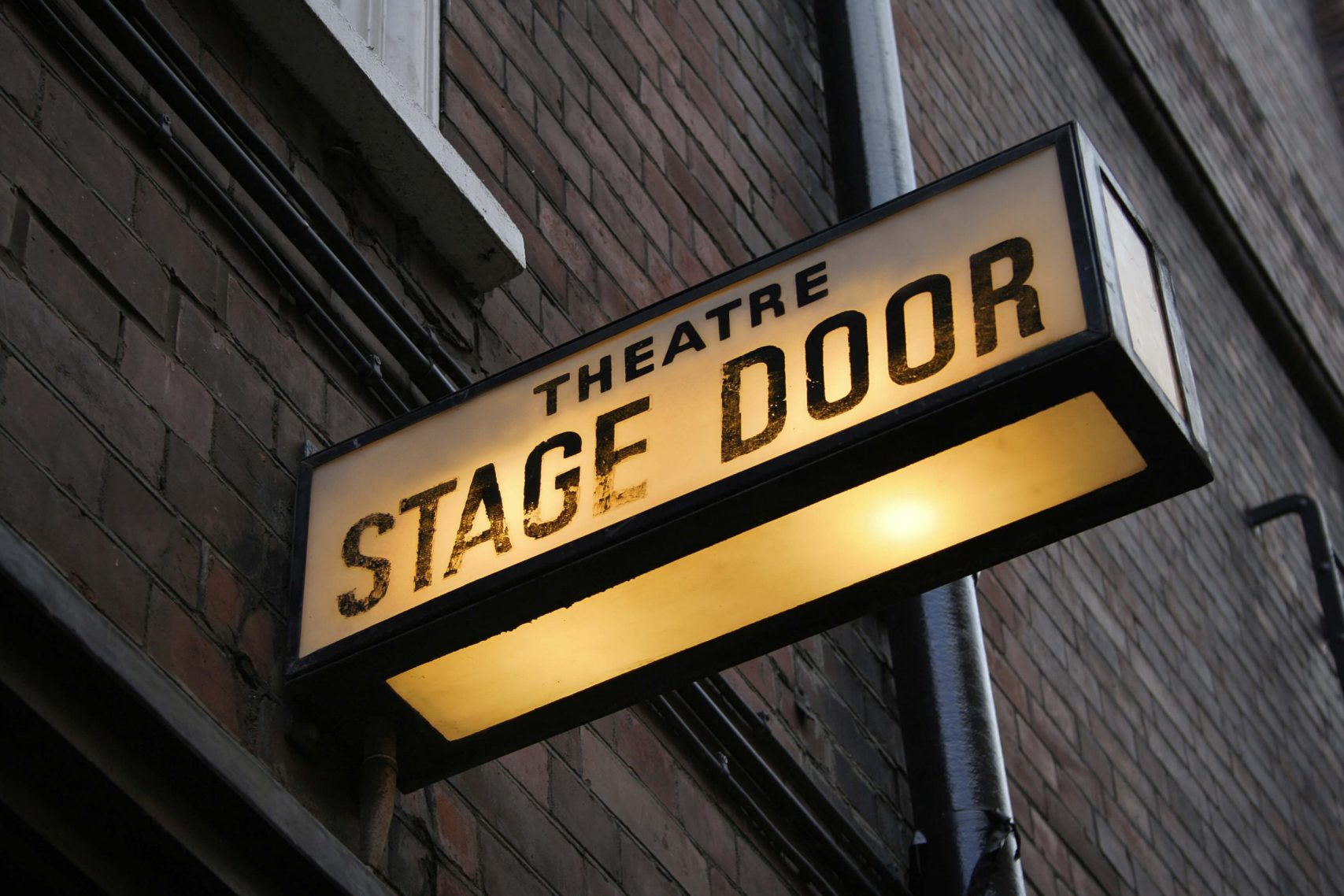 A sign of a theatre stage door